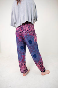 Rear-view mandala elephant pants in purple with model and white background-fullsize image