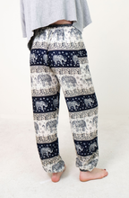 Load image into Gallery viewer, Rear-view chang thai elephant pants in navy with model and white background-half image