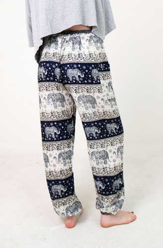 Rear-view chang thai elephant pants in navy with model and white background-half image