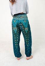Load image into Gallery viewer, Front-view peacock elephant pants in teal with model and white background-half-size image