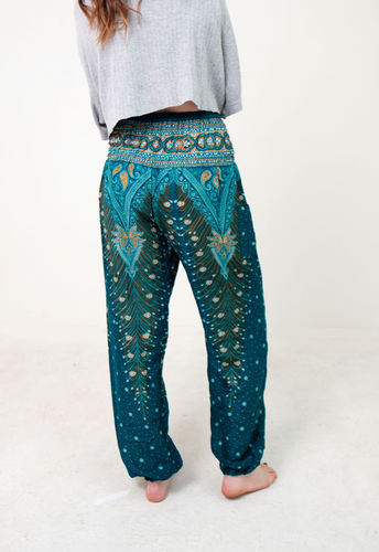 Front-view peacock elephant pants in teal with model and white background-half-size image