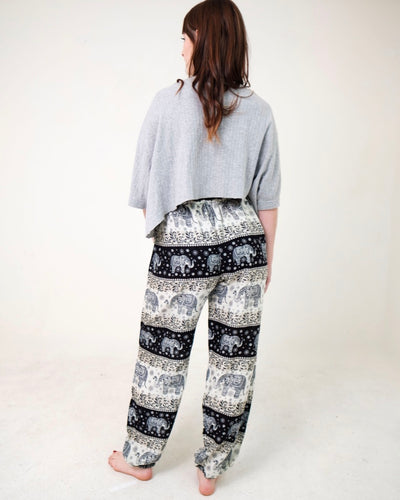 Rear-view chang thai elephant pants in black with model and white background-full size image