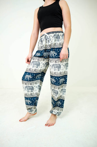 Front-view chang thai elephant pants in teal with model and white background-fullsize image