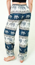 Load image into Gallery viewer, Rear-view chang thai elephant pants in teal with model and white background-halfsize image