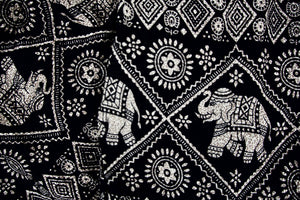 Close-up on imperial elephant pants pattern in black