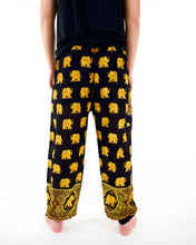 Load image into Gallery viewer, Rear-view golden elephant pants in black with model and white background-fullsize image