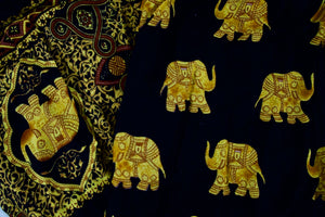 Close-up on golden elephant pants pattern in black