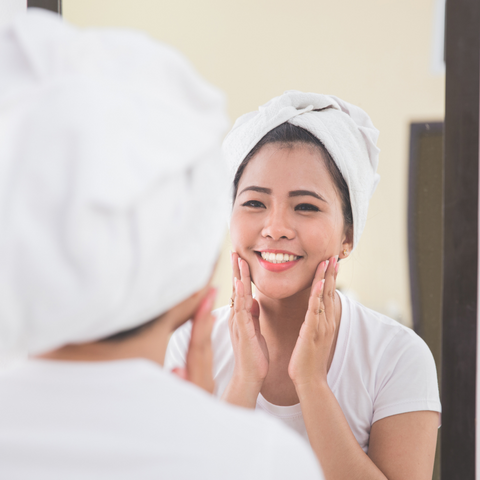 woman applying skincare