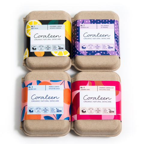 set of 4 boxed organic soaps with brightly coloured paper labels