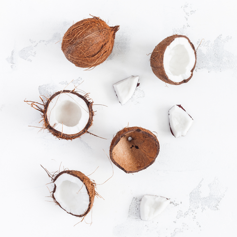 coconut flat lay some whole some broken open