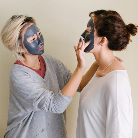 friends applying clay face masks