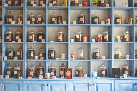 Blue wooden dresser with jars of herbs