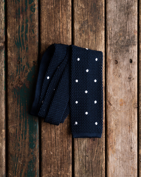 Navy with white polka dot knit tie