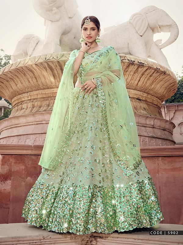 Rent Pista Green Soft Net Sequin Work Lehenga