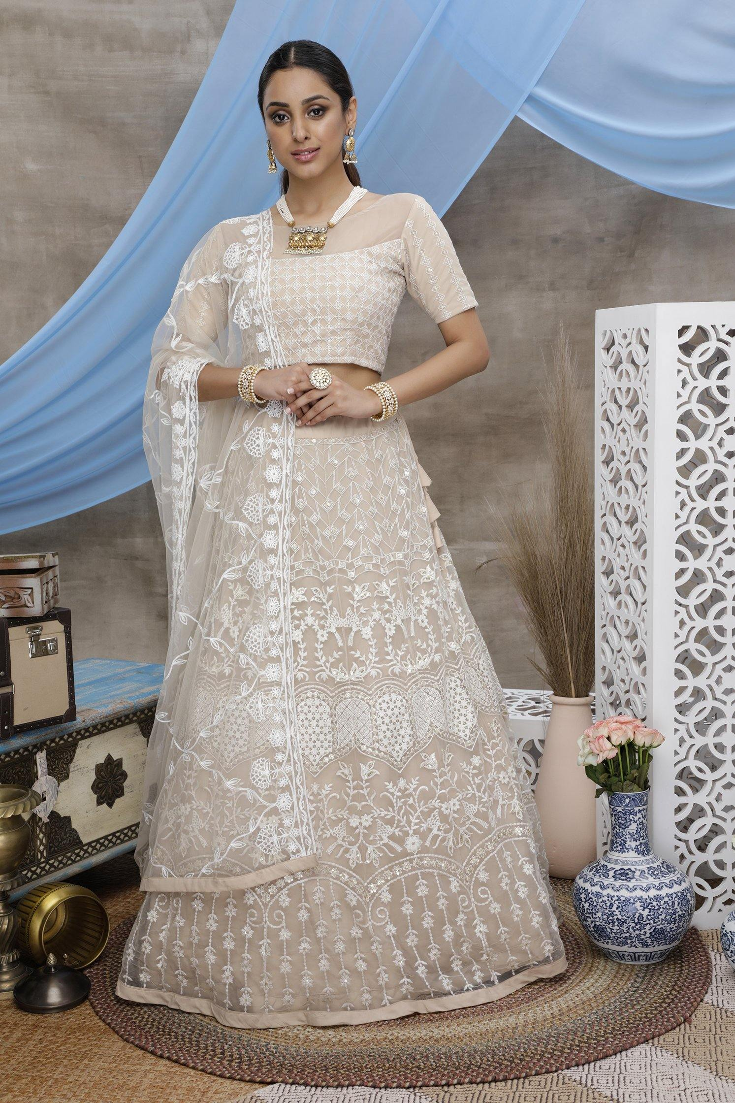 Rent Beige Net Bridal Lehenga Choli  with Sequince Embroidered Work