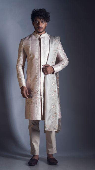 Raw Silk Powder Pink Sherwani with Intricate Pastel Knot Work Embroidery with an Embroidered Dupatta and Cream Churidar