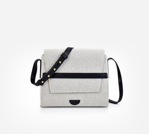 Yu bag in oreo black colour. Canvas leather handbag. Carry it over your shoulder. Waterproof canvas, genuine leather adjustable strap, inside lining, gold hardware, inside and back compartments.