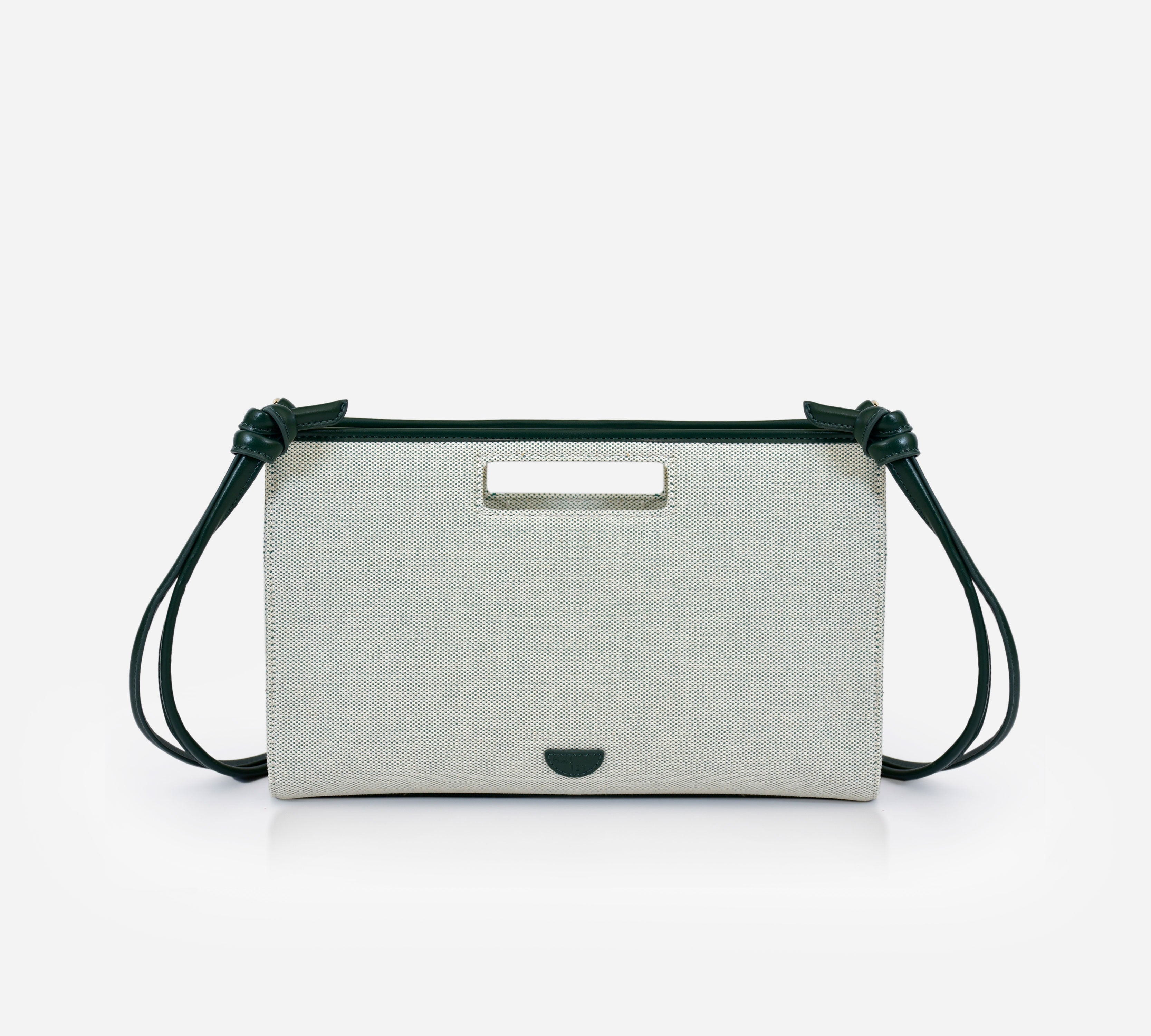 Lana bag in kale green colour. Canvas leather handbag. Clutch it or sling it. Waterproof canvas, genuine leather detachable strap, inside lining, gold hardware, inside and back compartments.
