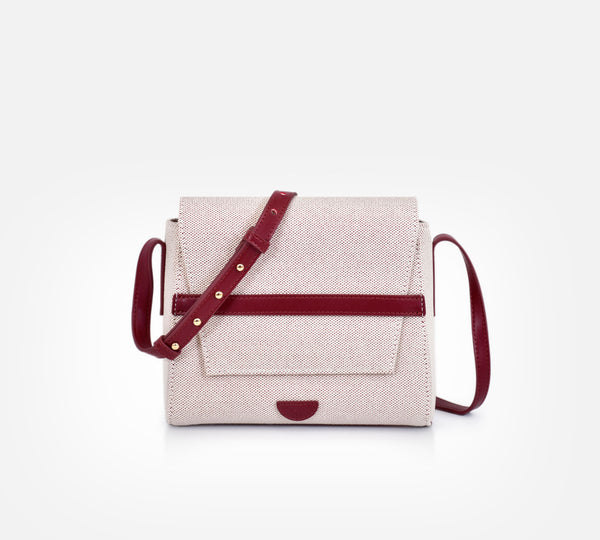 Yu bag in wine maroon colour. Canvas leather handbag. Carry it over your shoulder. Waterproof canvas, genuine leather adjustable strap, inside lining, gold hardware, inside and back compartments.