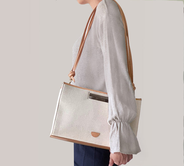 Every season, everyday canvas leather handbag. Clutch it, sling it. For modern women and their contemporary lifestyles.