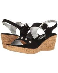 Ivette Suede Ankle Strap Wedge Sandal in Black