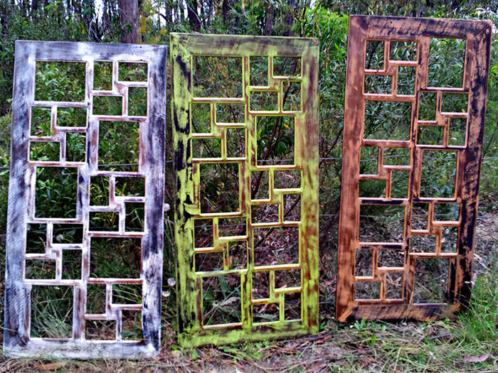 Funky Recycled Painted Timber Multi-photo Frames with 25 openings.