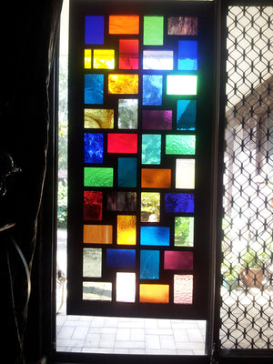 Stained Glass Screen  behind one of our large multi photo collage frames