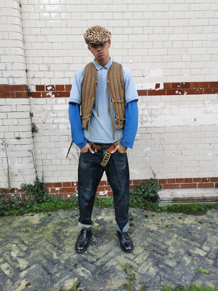 Youth wearing Seven Foot Cowboy jeans in a rude boy style