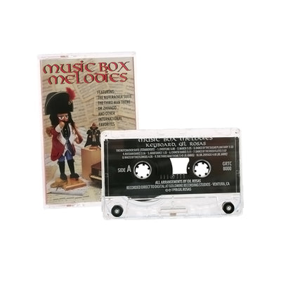 "Gil Rosas Casette Of Music Box Tunes - 4.25""""H X 2.75""""W X .75""""D"