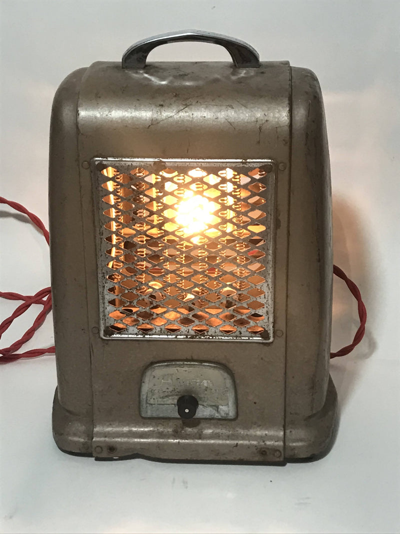 Repurposed vintage space heater into a lam