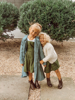 green linen pinafore dress