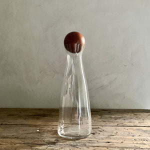 glass decanter with wood sphere stopper