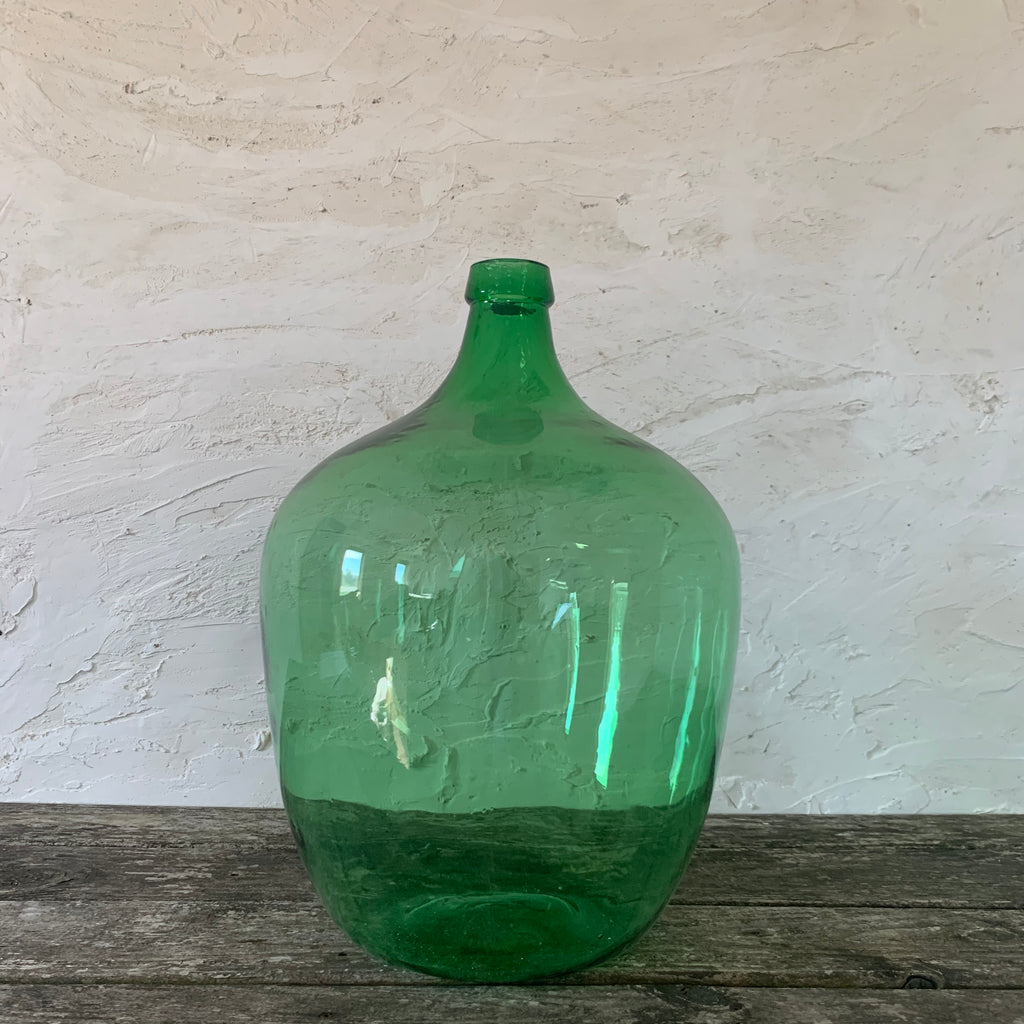 massive antiqued green glass wine jug