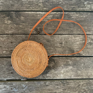 round straw bag with striped interior