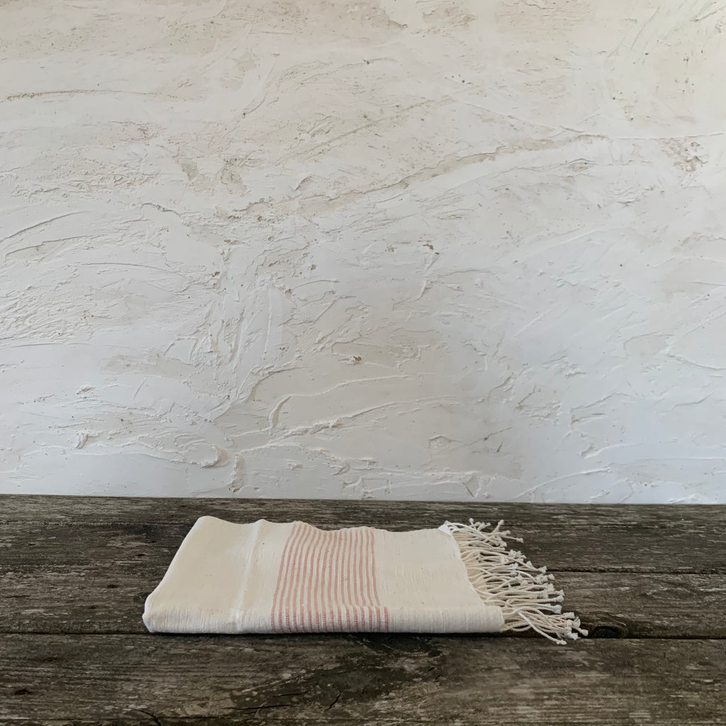 riviera fringed hand towel- natural with blush