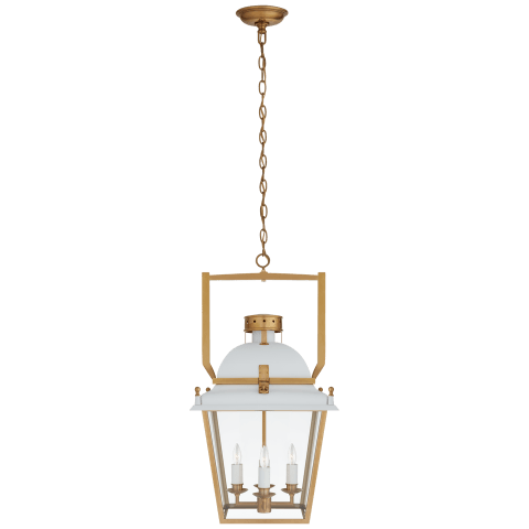 small white metal and brass lantern