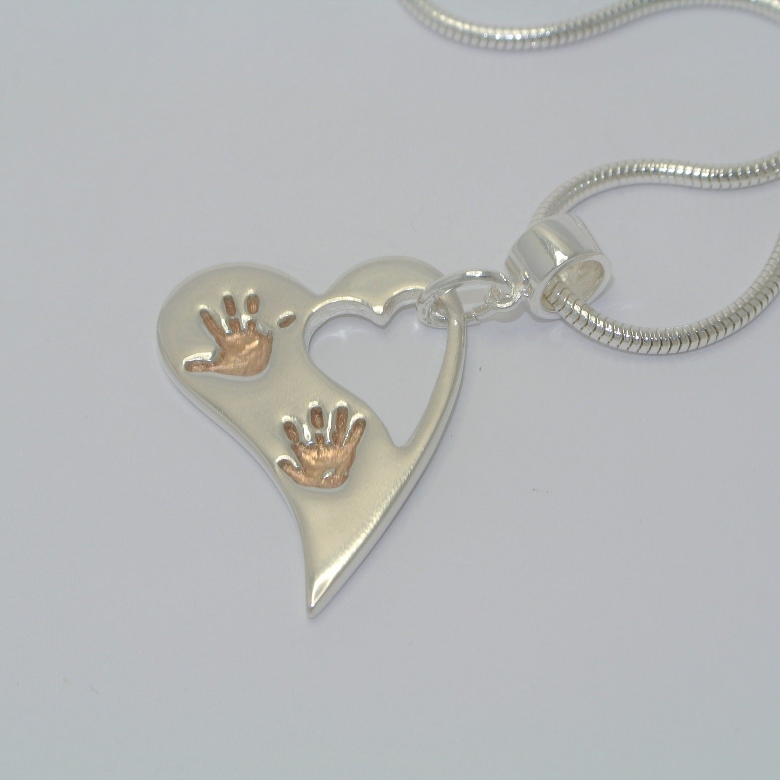 Wavy Heart, Two Handprints with Rose Gold. Sterling Silver Handprint Jewellery