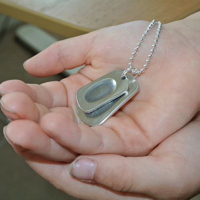 baby holding Fingerprint Dogtag Necklace