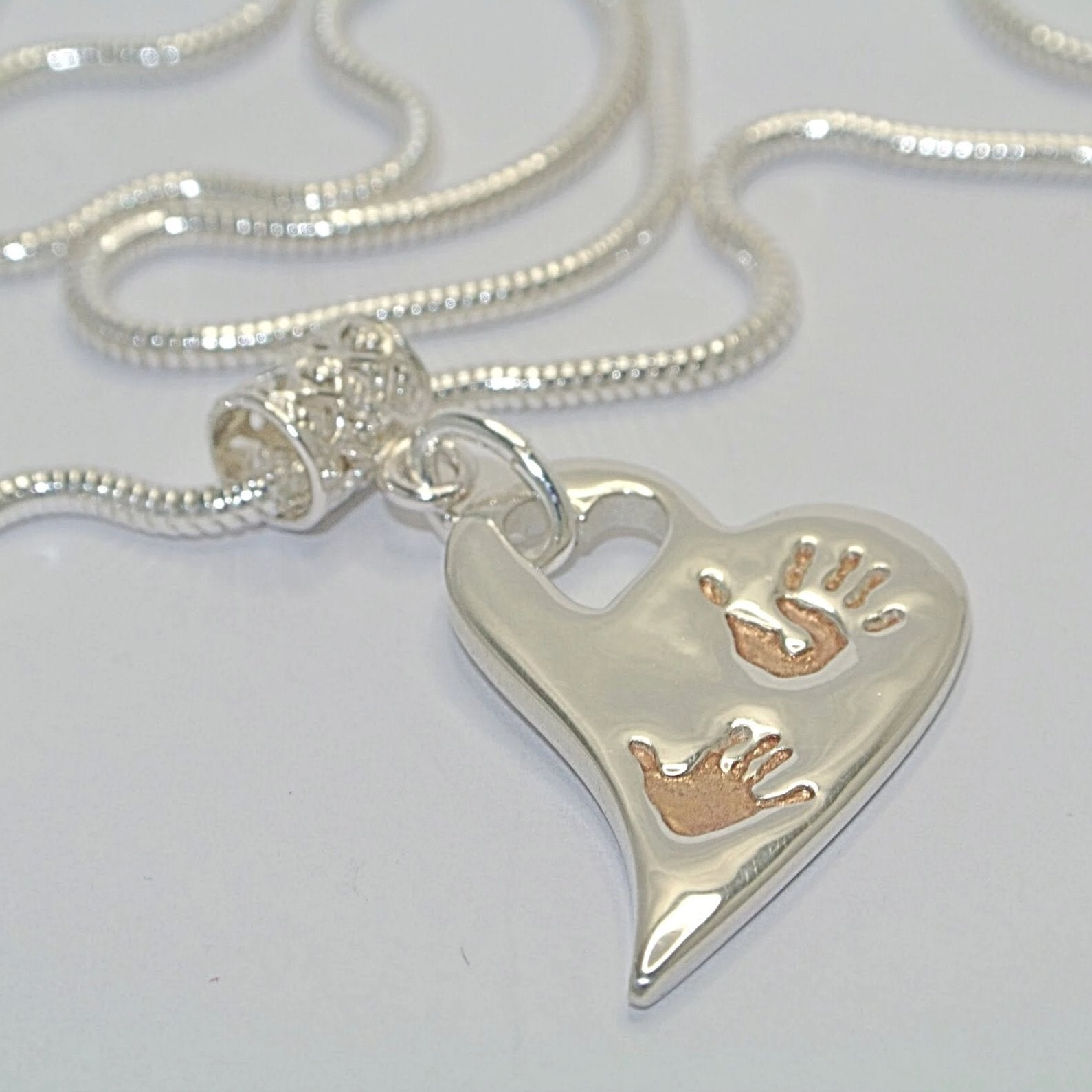 Wavy Heart with Up to Two Handprints with Rose Gold. Sterling Silver Handprint Jewellery