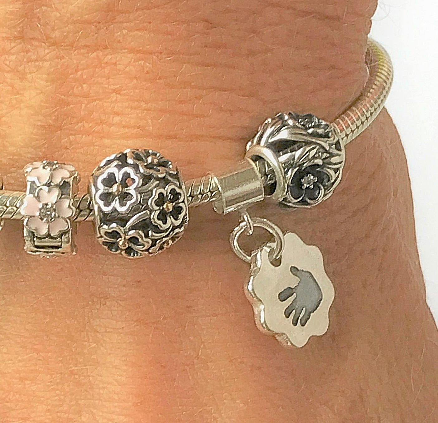 Lady wearing Bracelet Charm Sterling Silver Handprint Keepsake Jewellery