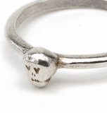 Close Up of Tiny Silver Skull on Thin Silver Ring
