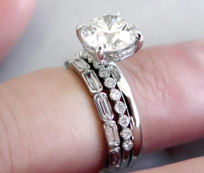 Gemma diamond solitaire engagement ring with two delicate wedding bands