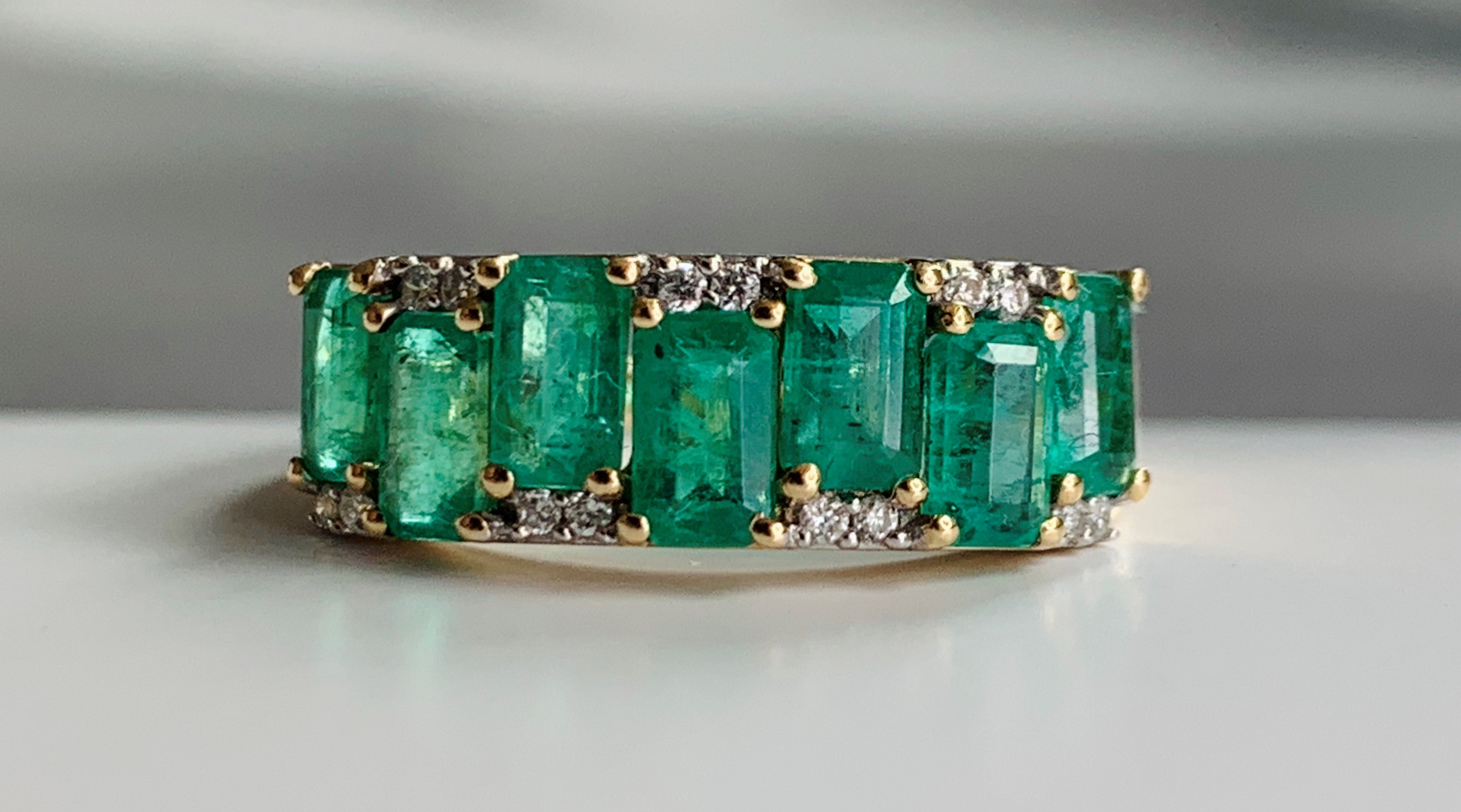 Emerald gold engagement band