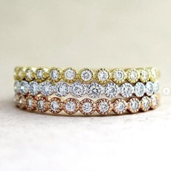 Arden band in yellow gold, white, gold and rose gold with diamonds.