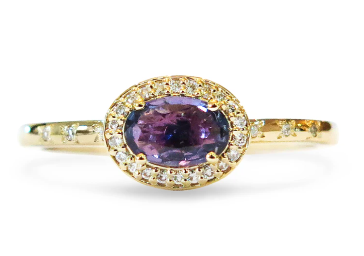 Purple sapphire and gold east-west oval engagement ring