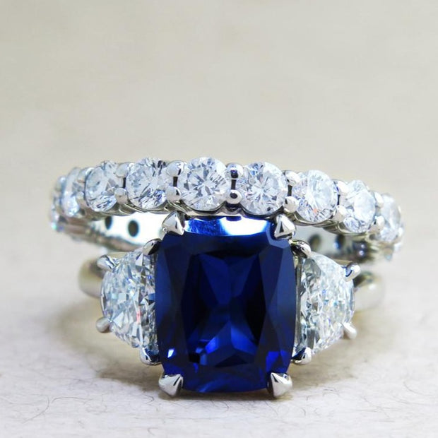 Alexandra 4 Carat Blue Sapphire Engagement Ring with Half-Moon Diamond Side Stones in White Gold by Dana Walden Bridal