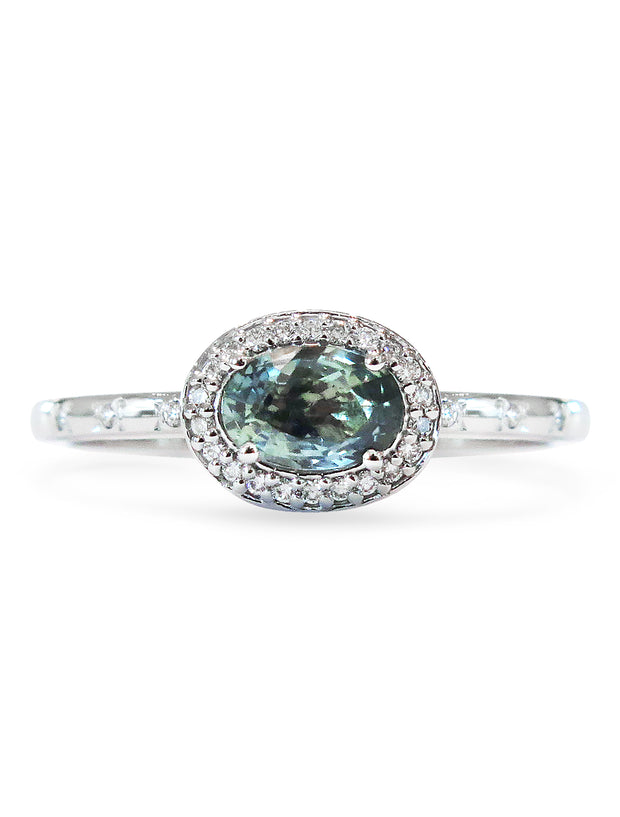 Blue-green sapphire engagement ring with east west diamond halo in white gold, designed by dana walden bridal