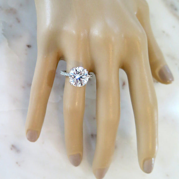 5 carat diamond engagement ring on hand in platinum with diamonds