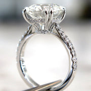 Side View of 5 carat diamond engagement ring with diamonds in delicate thin band