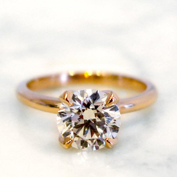 Astrid diamond solitaire engagement ring in rose gold with thin band